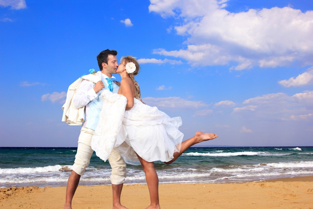 Wedding on the beach, young married couple on the beach